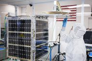 A satellite is worked on in Skybox Imaging's facilities in Mountain View, Calif.