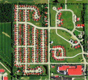 For Geostellar's system to work, it needed to be able to automatically and accurately distinguish buildings from vegetative types, such as the homes above in Washington County, Wis., shown in red. Depending on county size, it can take eCognition one minute to three hours to produce a building layer.