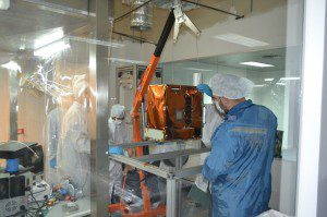 BugSat 1, Satellogic's final prototype Earth observation smallsat, is adjusted prior to launch.