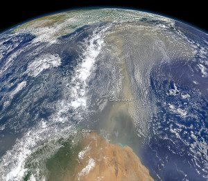 This composite image, made with data from the Visible Infrared Imaging Radiometer Suite on the Suomi NPP satellite, shows dust heading west toward South America and the Gulf of Mexico on June 25, 2014. The dust flowed roughly parallel to a line of clouds in the intertropical convergence zone, an area near the equator where the trade winds come together and rain and clouds are common.