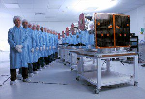 All five RapidEye satellites were lined up in SSTL's cleanroom, with some of the assembly, integration and test staff, before being sent to Baikonur in Kazakhstan for a successful launch on Aug. 29, 2008.