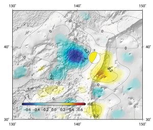 """This image portrays a """"gravity scar,"""" specifically, the changes in Earth's gravity field resulting from the earthquake that hit Japan on March 11, 2011. A combination of data from ESA's GOCE mission and the NASA–German Grace satellite shows the vertical gravity gradient change. The """"beachball"""" marks the epicenter"""