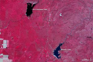 In this 2011 image acquired by NASA's ASTER instrument, California's landscape was comparatively lush with vegetation, which appears red, and the lakes were robust.