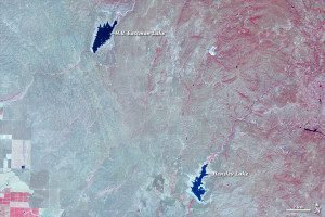 After three years of drought, this 2014 ASTER image shows a browned landscape and lakes that have shrunken considerably. In the lower-left corner, farmland doesn't appear to have changed much. In fact, some areas look like they have more vegetation in 2014, though that could be because the 2011 image was taken earlier in the spring.