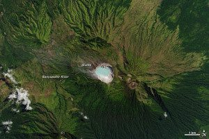 On Aug. 22, 2013, the Landsat 8 satellite captured this view of the lake in East Java, Indonesia. The turquoise color comes from the range of materials dissolved in the water, including hydrochloric and sulfuric acids. The craters of several other volcanoes are also visible within the 20-kilometer-wide (12-mile) Ijen caldera.