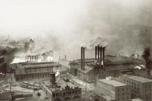 This 1906 photo shows Pittsburgh's Strip District neighborhood looking northwest from the roof of Union Station. The Fort Wayne Railroad Bridge, spanning the Allegheny River, is partly visible on the left.