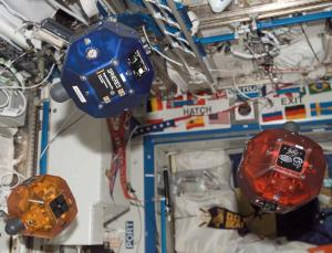 """In a test aboard the ISS the robots successfully maneuvered around an """"unknown"""" object floating in microgravity. Using their cameras and internal gyroscopes to navigate, they maintained a safe distance from the object as they filmed it."""