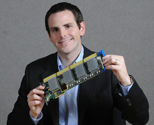 Sensor APEX Acting Director Bill Turri holds one of the research group's sensor processing boards.