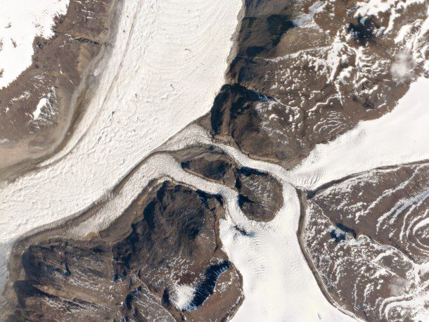 "This image captured by Planet Labs satellite ""Doves"" shows the West Greenland Glaciers, which drain the western Greenland Ice Sheet through Karrat Fjord and into Baffin Bay."