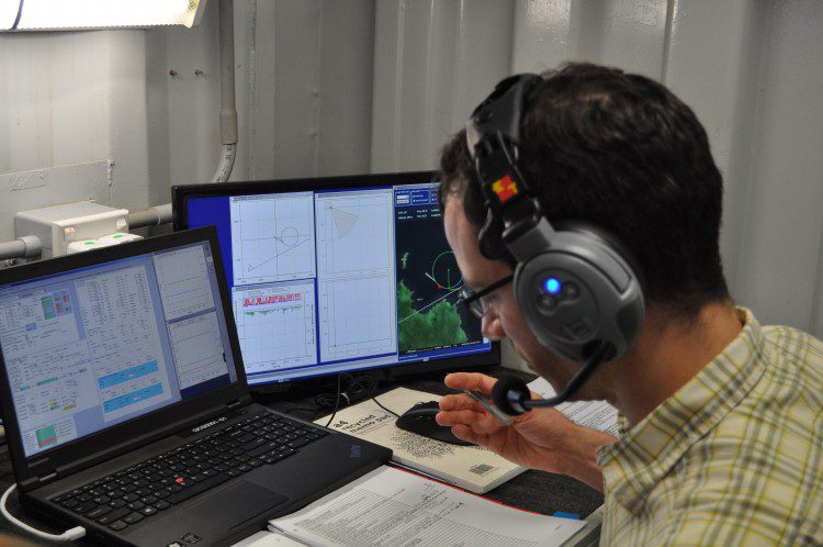 An image of the shipboard mission control reveals the mission checklist as well as the laptop and screen showing various sensor readings from an aircraft in flight.  Credit: Todd Steiner, Turtle Island Restoration Network