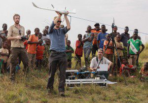 ConservationDrones team member Sander van Andel prepares to launch a drone in Tanzania. When the drone is launched, an accelerometer triggers the motor to start. (Credit: Lilian Pintea)