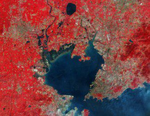 Sentinel-2A, which has been in orbit since June 2105, captured this false-color image of Qingdao, China. Boats can be seen entering and exiting the bay, which is crossed by the world's longest bridge over water: the 42-kilometer-long Jiaozhou Bay Bridge. (Credit: Copernicus Sentinel data (2015)/ESA)