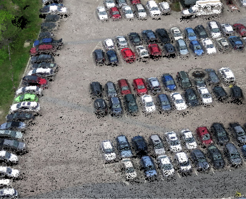 A point cloud of a parking lot was derived from UAS imagery containing more than 40 points per square meter. The point cloud is derived from stereo images through an automated process.