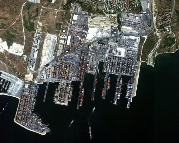 A satellite image (top) shows Istanbul, Turkey, with Ataturk International airport on the right and a sea-freight terminal on the left. A zoomed-in image of the freight terminal (bottom) shows boats waiting to unload, which can be used to lessen delays in unloading and delivery of goods.