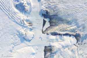 On April 7, 2016, the Moderate Resolution Imaging Spectroradiometer (MODIS) on NASA's Terra satellite acquired this image as the new icebergs broke away. For size comparison, the Drygalski Ice Tongue just south stretches 80 kilometers (50 miles) into the sea. (Credit: NASA Earth Observatory image by Jesse Allen, using data from LANCE)