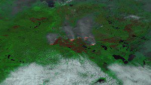 An enhanced image taken by NASA's Suomi NPP satellite on May 24, 2016, uses multiple channels on its VIIRS instrument, including visible and thermal imagery, to distinguish cloud, smoke, land and areas of active fires. (Credit: NOAA/NASA)