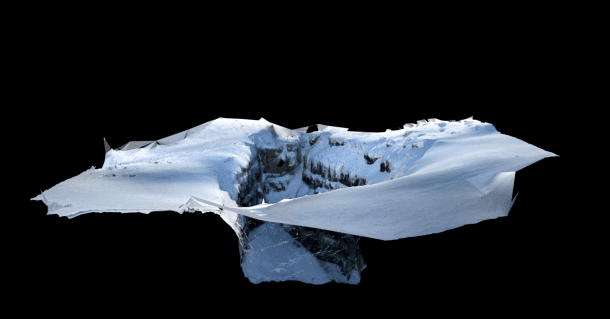 A photograph from a quad-copter UAS helped create a 3D model of the entrance of the cave, a large external doline covered by snow. RealityCapture software from Capturing Reality was used to produce a 3D point cloud and mesh model to generate georeferenced orthophotos and a digital surface model. (Credit: Tommasi Santagata)