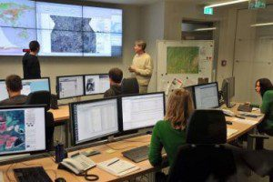 Scientists in a DLR situation room use satellite data to monitor a developing crisis. (Credit: DLR)