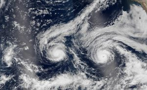 This natural-color image is a composite built from two overpasses by the Visible Infrared Imaging Radiometer Suite (VIIRS) on the Suomi NPP satellite on Aug. 29, 2016. At the time, Hurricane Madeline and Hurricane Lester were hovering between category 3 and 4 storms. (Credit: NASA Earth Observatory image by Jesse Allen, using VIIRS data from the Suomi National Polar-orbiting Partnership)
