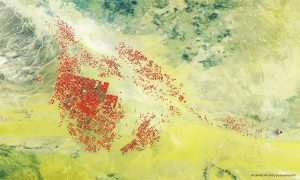 This Proba-V image shows agricultural fields fed underground water by circular-pivot irrigation systems, amid Saudi Arabia's yellowish desert sands and surrounding low hills and rocks. (Credit: ESA/Belspo – produced by VITO)