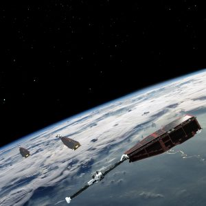 Two Swarm satellites orbit almost side-by-side at the same altitude, while a third satellite is in a higher orbit and at a slightly different inclination. The different orbits optimize the sampling in space and time, distinguishing between the effects of different sources and strengths of magnetism. (Credit: ESA/AOES Medialab)