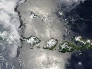 In this image captured by NASA's Aqua satellite, sunglint exposes waves created by currents in the ocean water of Indonesia's Lombok Strait. (Credit: Jeff Schmaltz, MODIS Land Rapid Response Team, NASA GSFC)